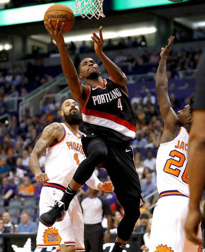 Portland Trail Blazers forward Maurice Harkless (4) shoots as Phoenix Suns forward Josh Jackson (20) defends and center Tyson Chandler (4) watches during the second half of an NBA basketball game, Wednesday, Oct. 18, 2017, in Phoenix. (AP Photo/Matt York)