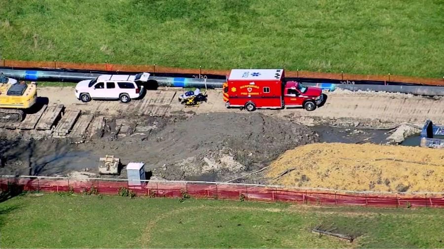 Two workers suffered serious injuries after one fell on top of the other Friday in an Elgin trench.