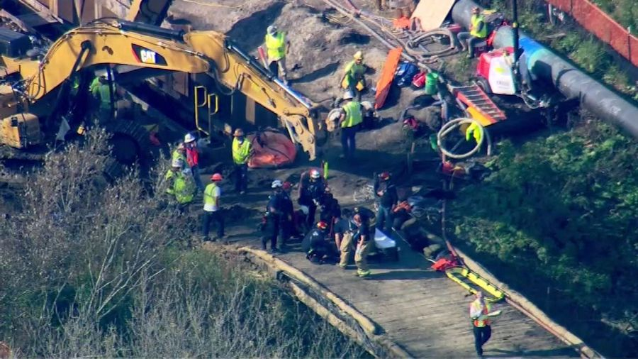 Rescue workers used ropes and pulleys to raise two injured workers from an Elgin trench.