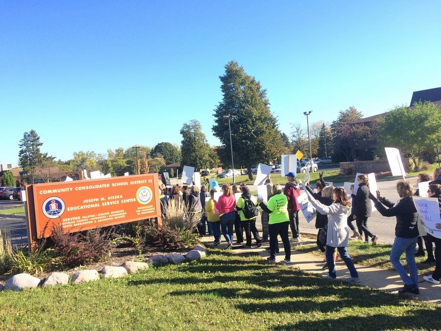 Striking support employees and their supporters, totaling about 300 people, rallied near Palatine Township Elementary District 15 headquarters in the village Wednesday while contract negotiations occurred inside. Contract talks are to resume Sunday.
