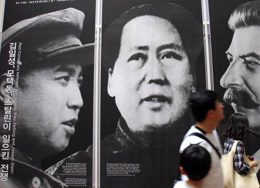 Chinese power over north korea its more myth than reality file in this may 21 2010 file photo visitors look at posters thecheapjerseys Choice Image