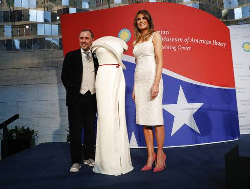 First lady Melania Trump donates her inaugural gown, designed by Herve Pierre, left, to the First Ladies' Collection at the Smithsonian's National Museum of American History, during a ceremony in Washington, Friday, Oct. 20, 2017. (AP Photo/Pablo Martinez Monsivais)