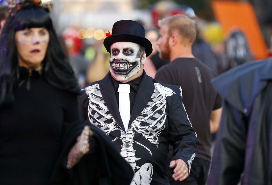 People make their way onto Chicago Street during Nightmare on Chicago Street on Saturday in Elgin.