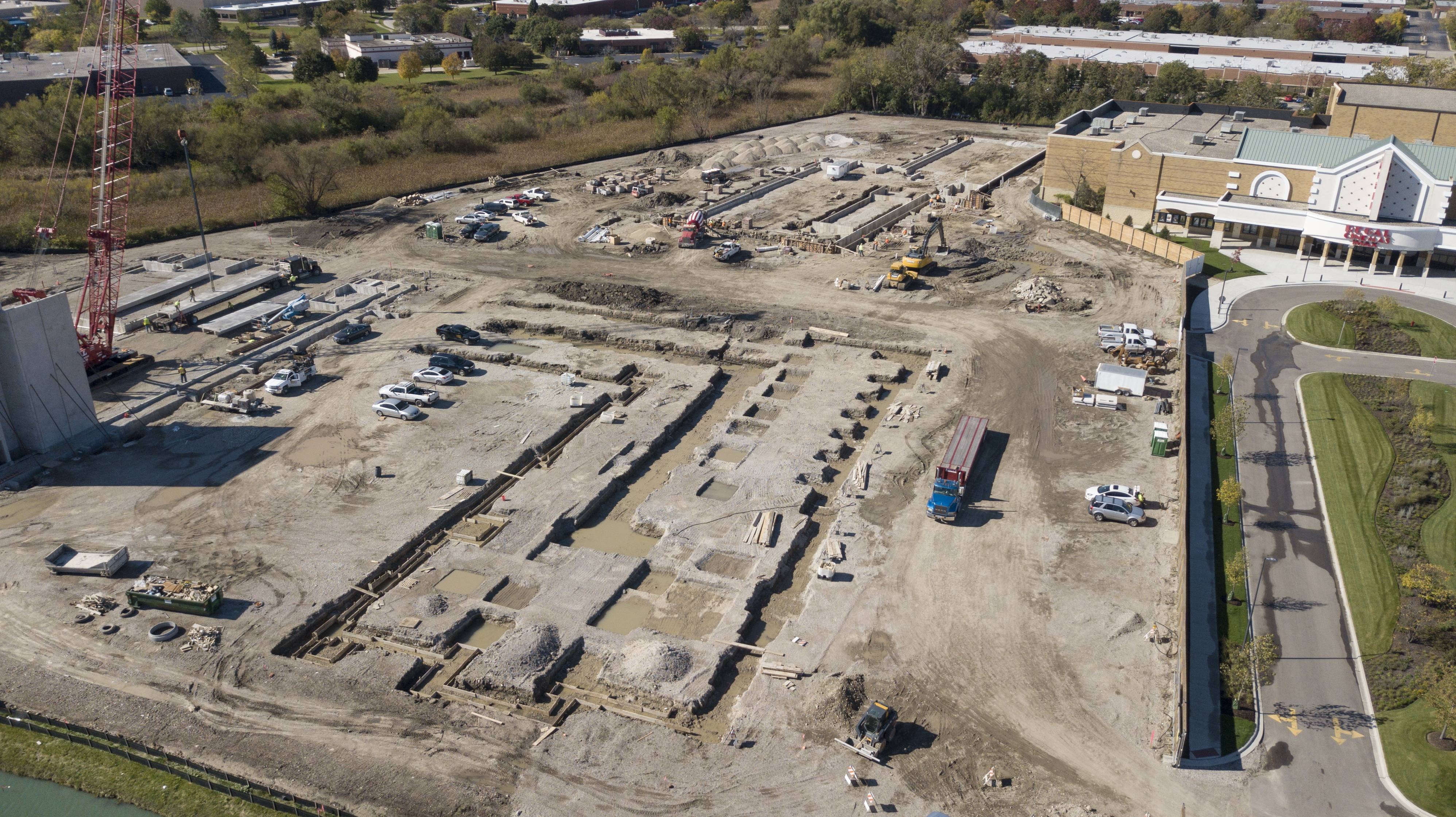 Regal Cinemas in Lincolnshire gave up some of its land to accommodate the village's first apartment complex, under construction at left, as shown by this Daily Herald drone photo.