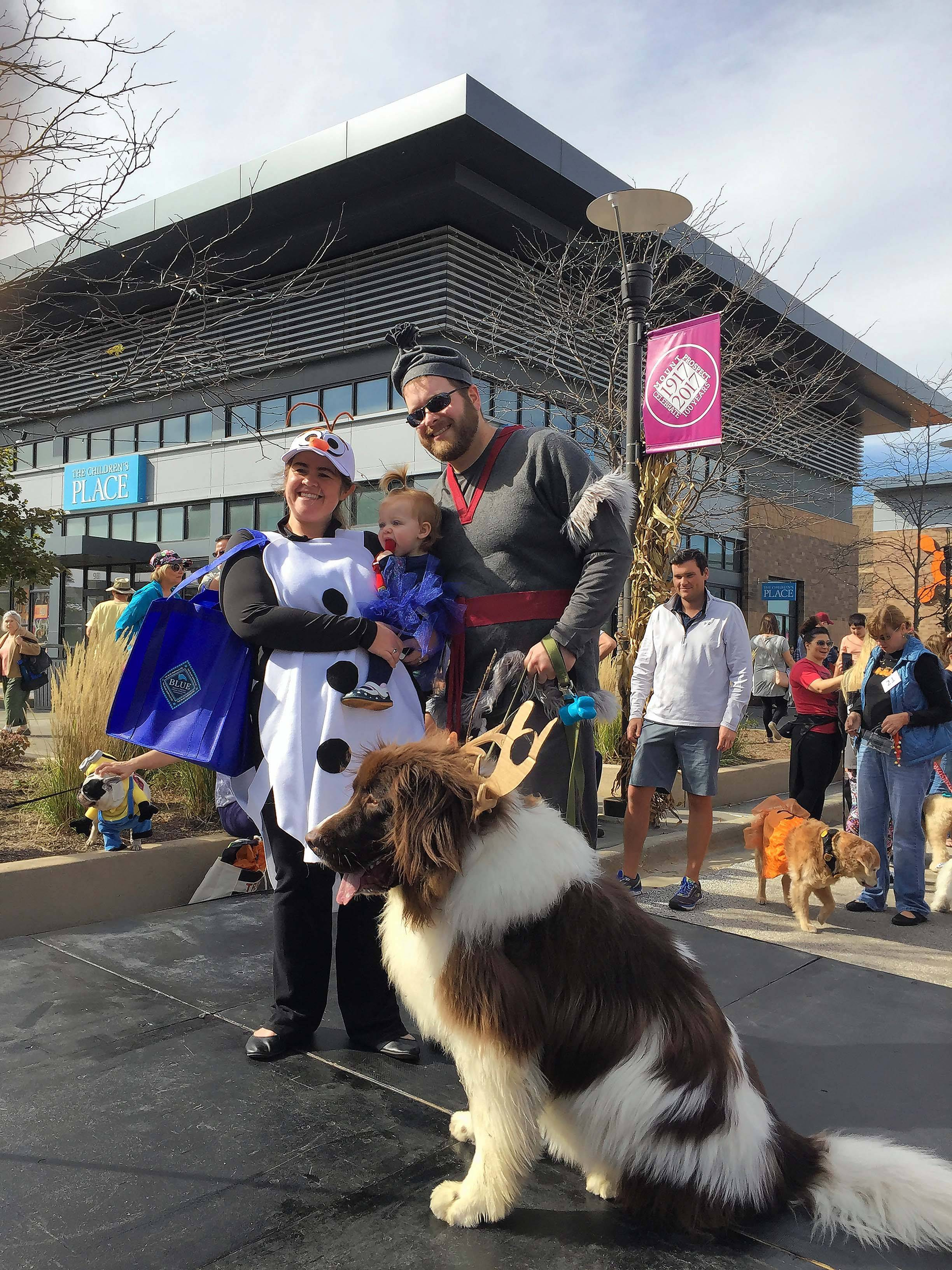 "Biff, dressed as Sven the Reindeer from ""Frozen."" poses with his family Kiel, Colleen and Emmy Quatman from Arlington Heights after winning the pet parade at the Randhurst Village Halloween Fall Festival."