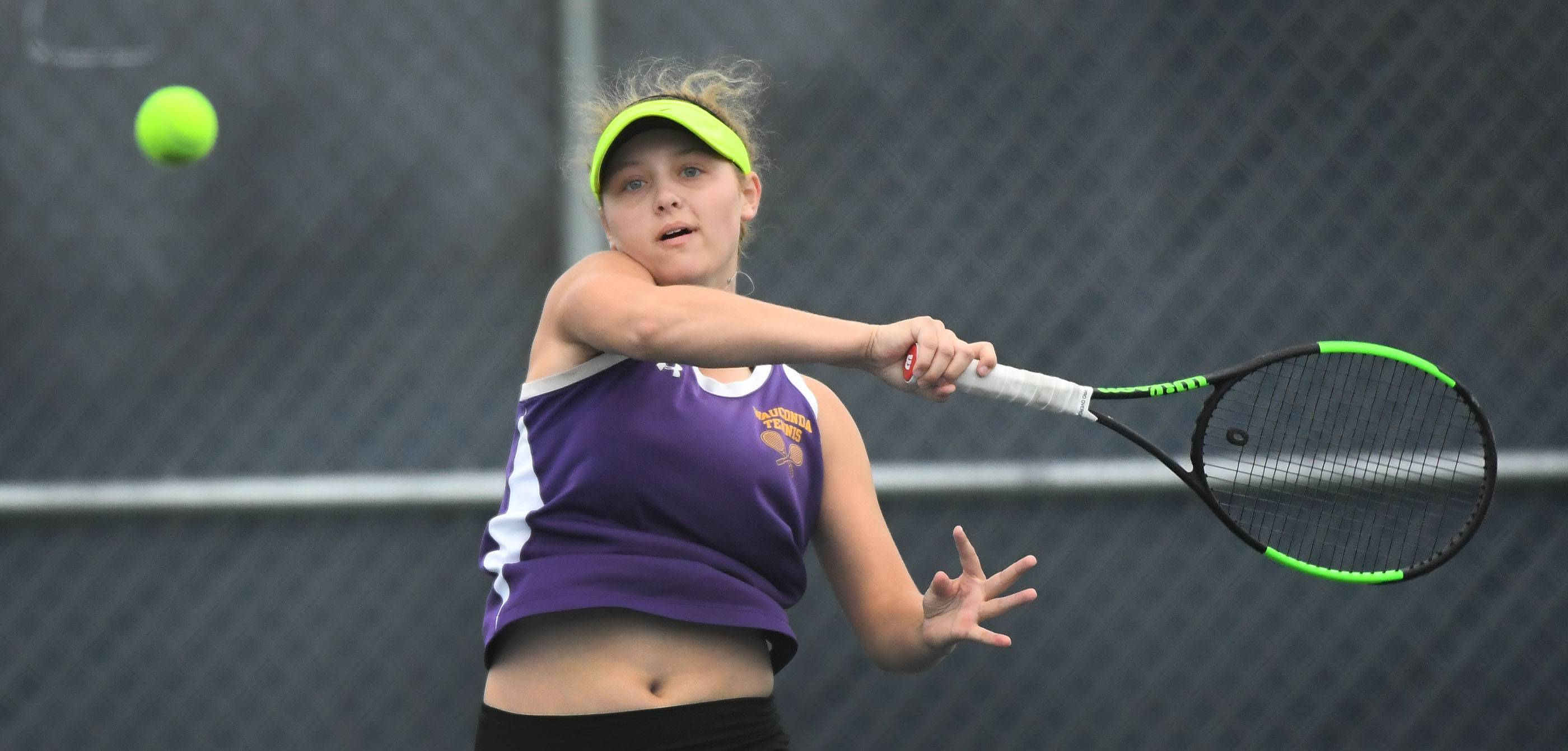 Wauconda's Sarah Hackman measures a forehand in Class 1A state semifinal play against Lakes' Megan Heuser on Saturday at Buffalo Grove High School.