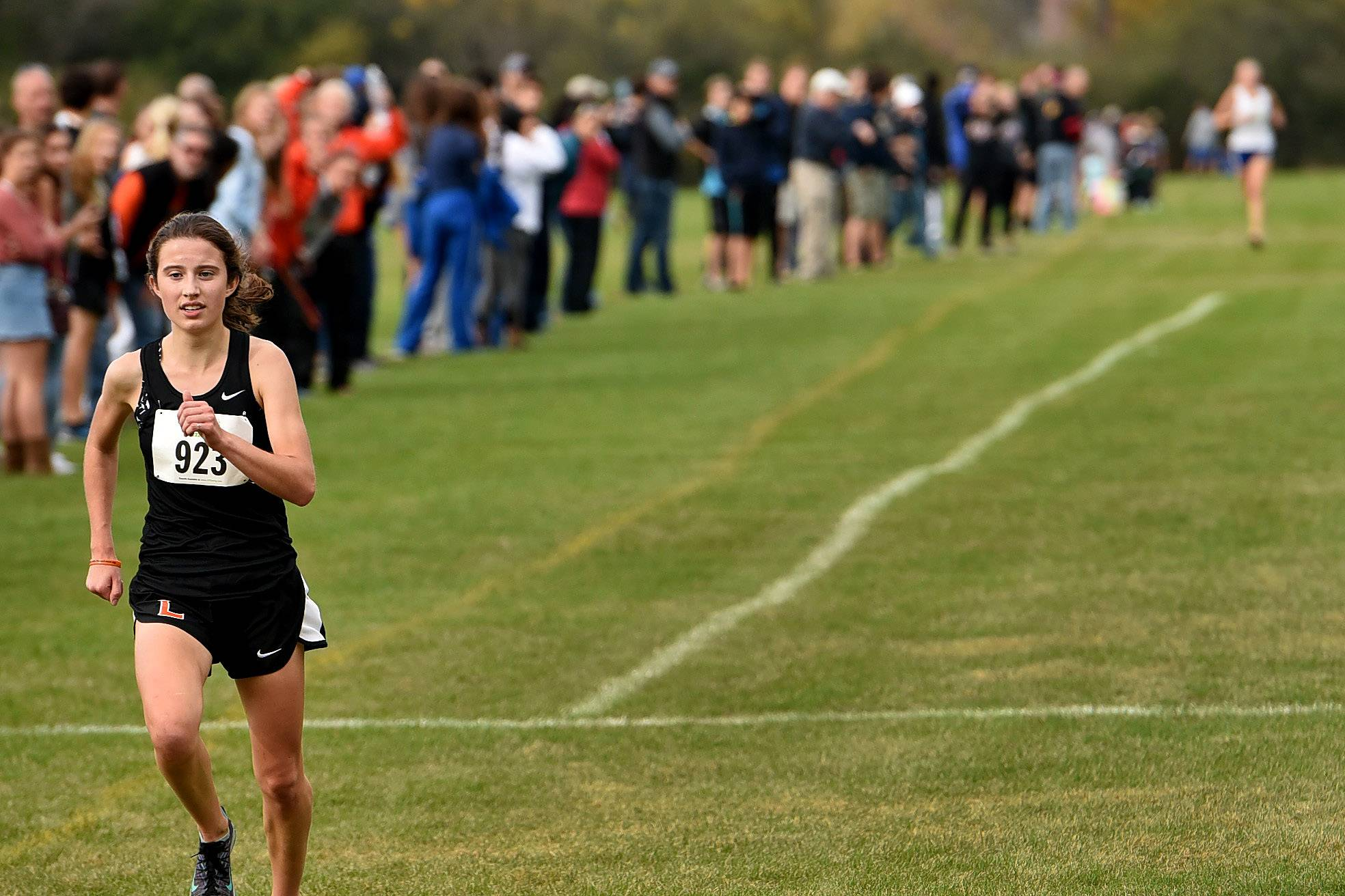 Melissa Manetsch of Libertyville has a huge lead in finishing ahead of Lake Forest's Brett Chody in the Class 3A Lake Forest regional. Manetsch finished in 16:57.8.