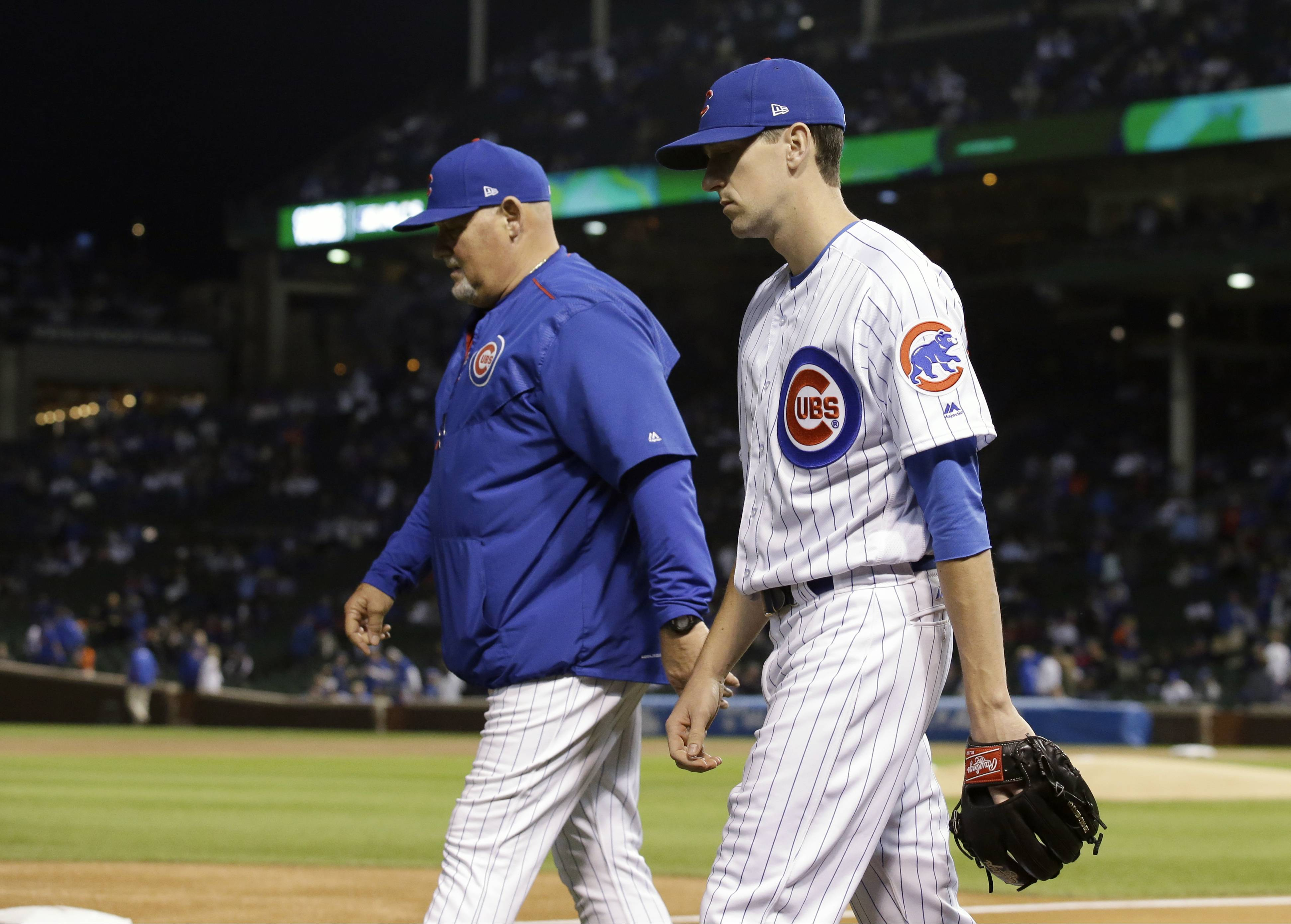 Chicago Cubs' Kyle Hendricks, right, walks to bullpen to warm up with pitching coach Chris Bosio before Game 3 of baseball's National League championship series against the Los Angeles Dodgers, Tuesday, Oct. 17, 2017.