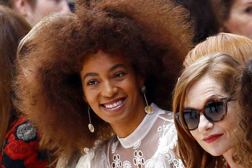 "FILE - In this Thursday, March 2, 2017 file photo, U.S singer Solange Knowles, left, and french actress Isabelle Huppert, right, look on prior to the show for Chloe's Fall-Winter 2017-2018 ready to wear fashion collection presented in Paris. Britain's Evening Standard newspaper has apologized to Solange Knowles for digitally altering an image of the singer on the cover of its magazine. Knowles, who had released a song called ""Don't Touch My Hair,� complained on Instagram that a braided crown on her head had been digitally removed from the cover photo. (AP Photo/Francois Mori, File)"