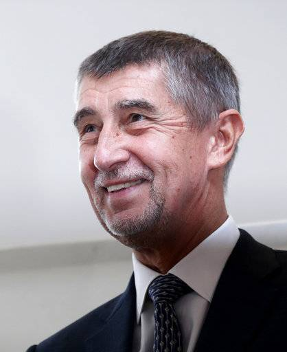 Czech billionaire and leader of the ANO 2011 political movement Andrej Babis smiles before casting his vote during the parliamentary elections in Pruhonice, Czech Republic, Friday, Oct. 20, 2017. Czechs are voting in a parliamentary election whose result could see yet another euro-skeptic government on the continent. Two hundred seats are up for grab in the lower house of Parliament in the two-day ballot that began on Friday. (AP Photo/Petr David Josek)