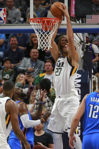 Utah Jazz center Rudy Gobert (27) dunks during the second quarter against the Oklahoma City Thunder in an NBA basketball game Saturday, Oct. 21, 2017, in Salt Lake City. (AP Photo/Chris Nicoll)