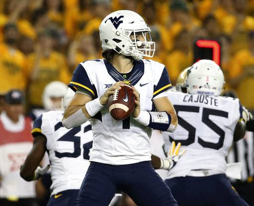 West Virginia quarterback Will Grier (7) drops back against Baylor in the first half of an NCAA college football game, Saturday, Oct. 21, 2017, in Waco, Texas. (AP Photo/Jerry Larson)