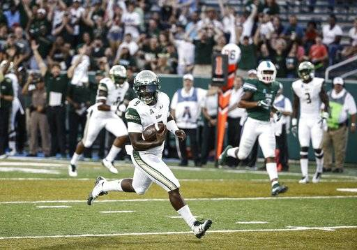South Florida quarterback Quinton Flowers (9) runs for a touchdown against Tulane during the first half of an NCAA college football game in New Orleans, La., Saturday, Oct. 21, 2017. (AP Photo/Derick E. Hingle)