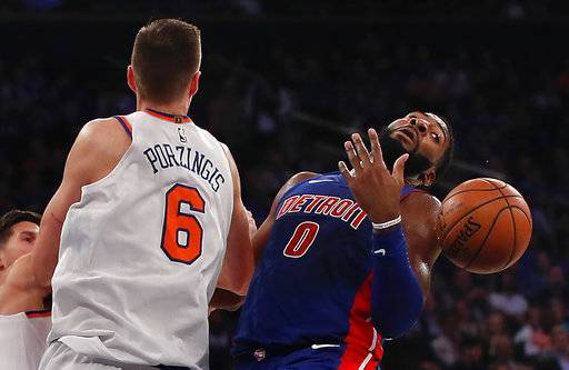 New York Knicks forward Kristaps Porzingis (6) and Detroit Pistons center Andre Drummond (0) battle for a rebound during the first quarter of an NBA basketball game, Saturday, Oct. 21, 2017, in New York. (AP Photo/Julie Jacobson)