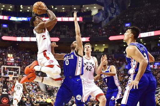 Toronto Raptors guard DeMar DeRozan (10) shoots over Philadelphia 76ers guard Jerryd Bayless (0) as Raptors centre Jakob Poeltl (42) and 76ers forward Dario Saric (9) look on during first half NBA basketball action in Toronto on Saturday, Oct. 21, 2017. (Frank Gunn/The Canadian Press via AP)