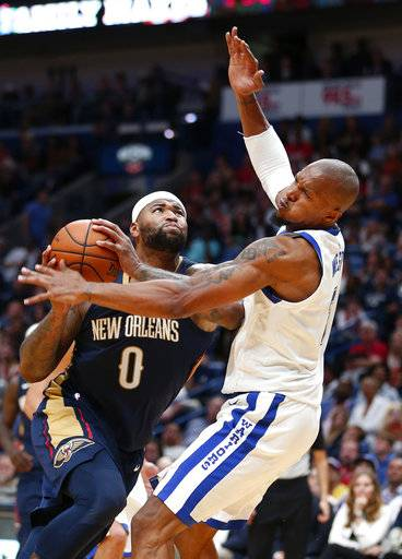 New Orleans Pelicans forward DeMarcus Cousins (0) commits an offensive foul against Golden State Warriors forward David West as he drives to the basket during the second half of an NBA basketball game in New Orleans, Friday, Oct. 20, 2017. The Warriors won 128-120. (AP Photo/Gerald Herbert)