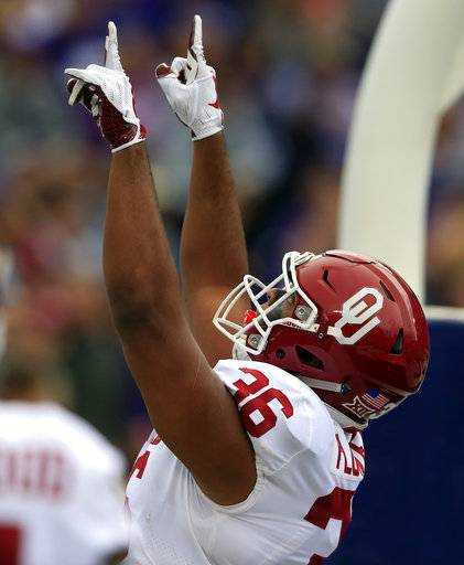 Oklahoma fullback Dimitri Flowers (36) celebrates a touchdown during the first half of an NCAA college football game against Kansas State in Manhattan, Kan., Saturday, Oct. 21, 2017. (AP Photo/Orlin Wagner)