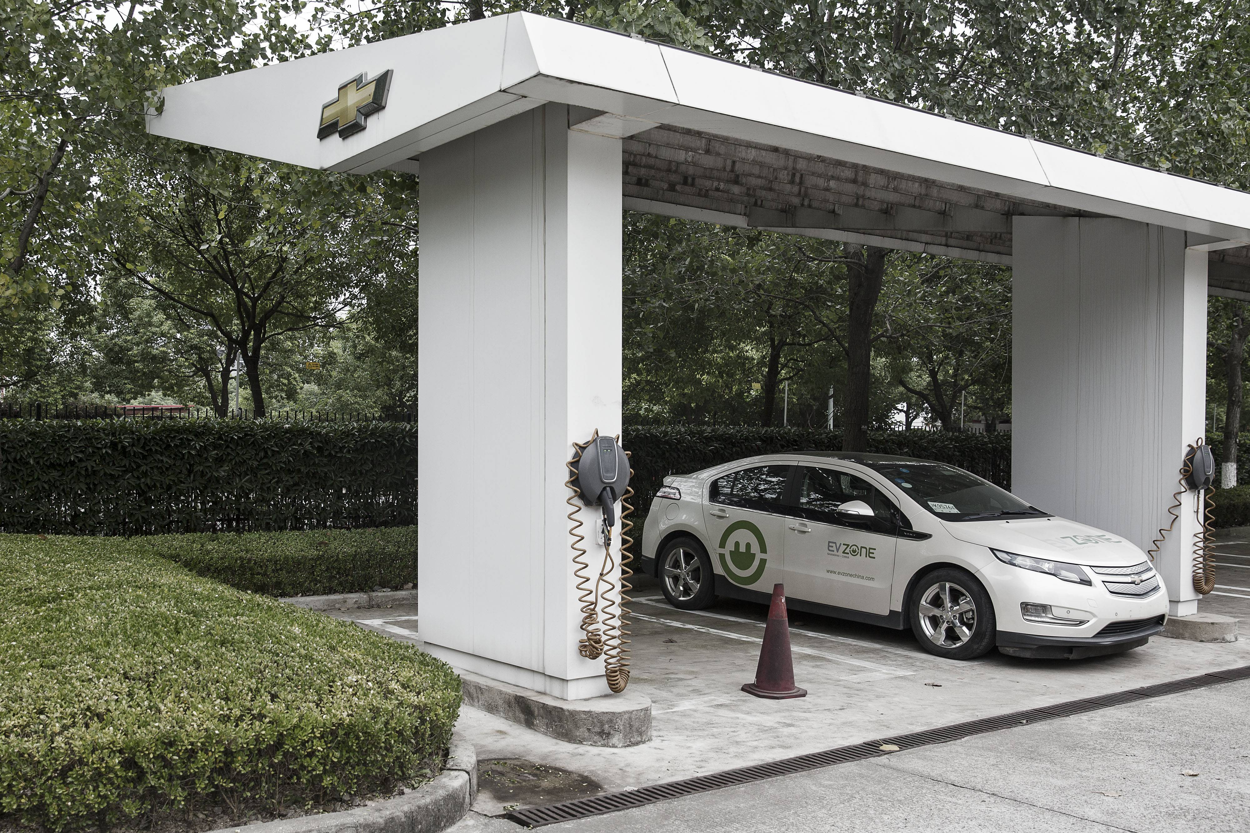A Chevrolet Volt electric vehicle sits parked at a charging station at the General Motors China headquarters in Shanghai, China.