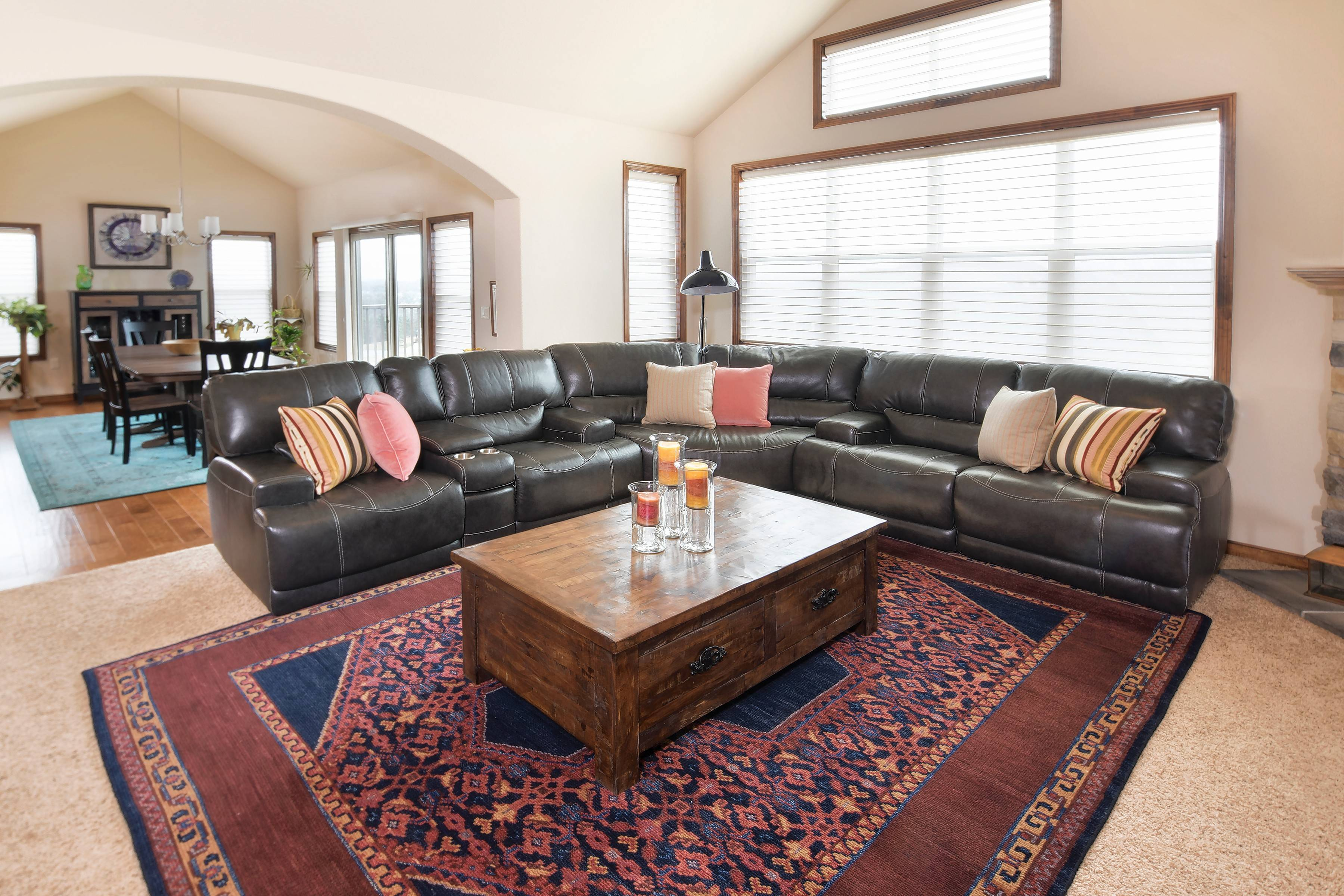 Adding an area rug, even over carpeting, is another way to brighten up a room.