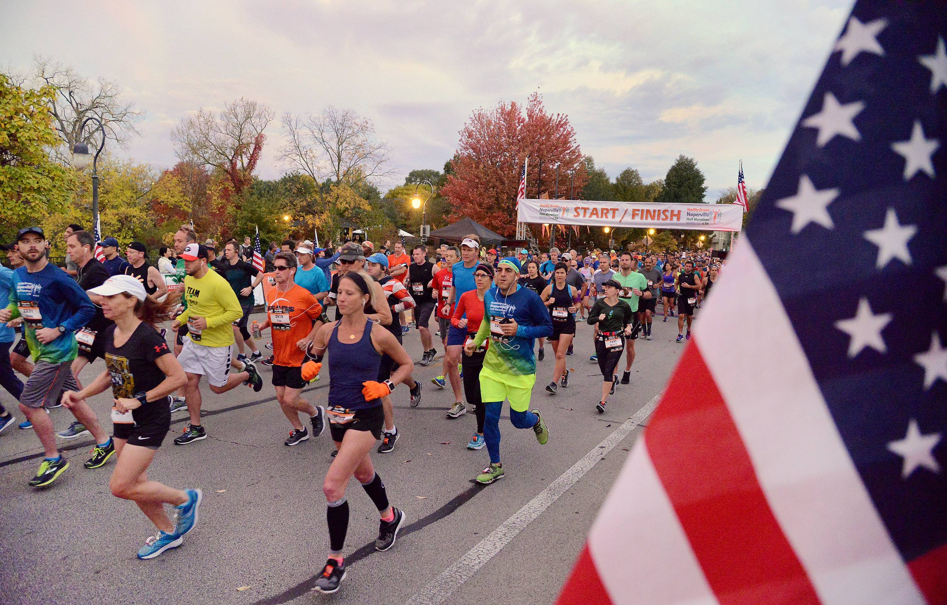 Thousands of participants in the Healthy Driven Naperville Half Marathon take off Sunday morning from the starting line on Eagle Street.