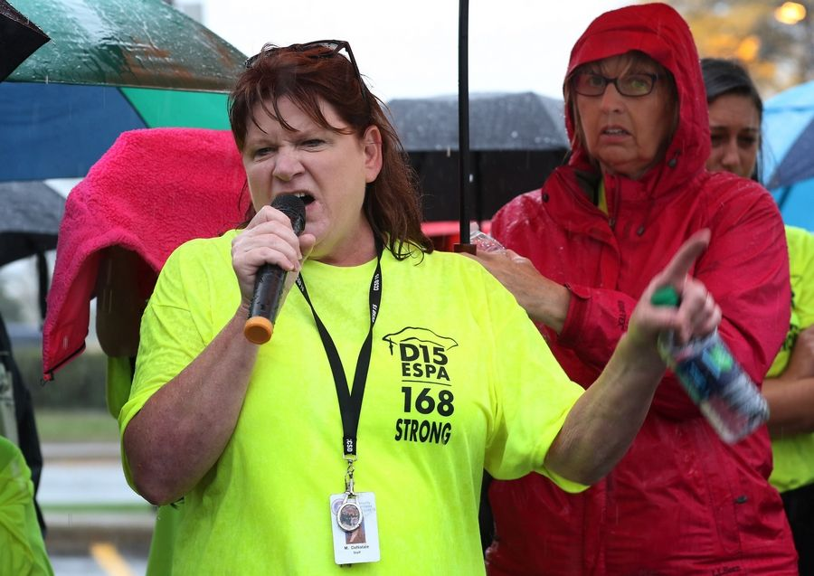 Marla DeNatale talks about her hardships during a protest rally Sunday by the Educational Support Personnel Association. DeNatale said Palatine Township Elementary District 15 cut off her health insurance even though she returned to work under a court order last week/.