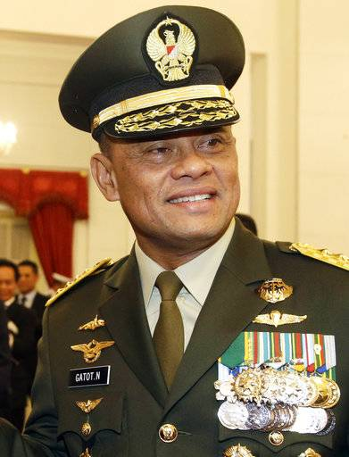FILE - In this Wednesday, July 8, 2015 file photo, Indonesian Armed Forces Chief Gen. Gatot Nurmantyo pose for a photo after his swearing-in ceremony at the presidential palace in Jakarta, Indonesia. Indonesia's government is seeking clarification from the U.S. after Nurmantyo was denied entry to the country. (AP Photo/Achmad Ibrahim, File)