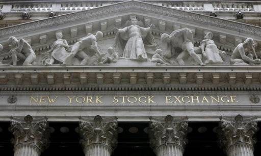 FILE - This Thursday, Oct. 2, 2014, file photo, shows the facade of the New York Stock Exchange. U.S. stocks were up slightly in early trading Friday, Oct. 20, 2017, as investors cheered a crop of strong company earnings. (AP Photo/Richard Drew, File)