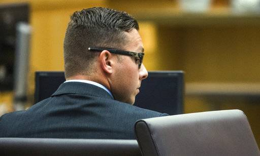 FILE - This May 16, 2016 file photo shows former Mesa, Ariz., Police Officer Philip Brailsford in Maricopa County Superior Court during a hearing. Brailsford goes on trial the week of Oct. 23, 2017, on a murder charge in the January 2016 shooting death of Daniel Shaver of Granbury, Texas, at a hotel in Mesa. Brailsford has said he shot Shaver because he believed Shaver was reaching for a gun during a tense encounter outside his hotel room. Prosecutors say no gun was found on Shaver's body and maintain the on-duty shooting wasn't justified. (Tom Tingle/The Arizona Republic via AP, Pool, File)