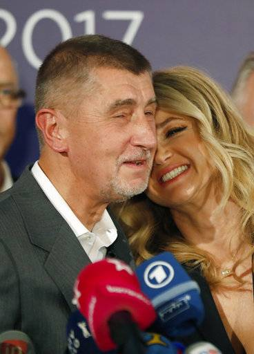 Czech billionaire and leader of ANO 2011 political movement Andrej Babis accompanied with his wife Monika addresses the media after most of the votes were counted in the parliamentary elections in Prague, Czech Republic, Saturday, Oct. 21, 2017. The centrist ANO movement led by populist billionaire Andrej Babis decisively won the Czech Republic's parliamentary election Saturday in a vote that shifted the country to the right and paved the way for the euroskeptic to lead the country. (AP Photo/Petr David Josek)