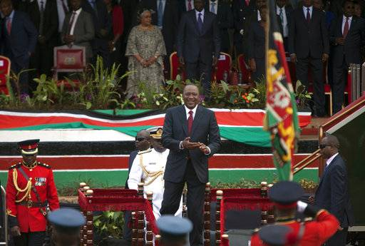Kenyan President Uhuru Kenyatta, smiles as he arrives at Uhuru Park, Nairobi, Kenya, Friday, Oct. 20, 2017, as he leads the nation in marking Mashujaa Day (Heroes Day). (AP Photo/Sayyid Abdul Azim)