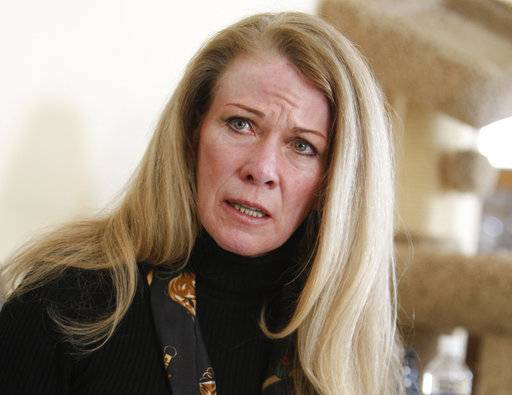 FILE - In this March, 5, 2009, file photo, Vicki Marble, a Larimer County bail business owner, speaks during an interview in Loveland, Colo. A Cub Scout was kicked out of his group after he questioned Republican state Sen. Marble about gun control and previous contentious comments she made about African-Americans. (AP Photo/Jack Dempsey, File)