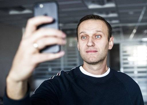 "Russian opposition leader Alexei Navalny takes a selfie at his office after been released from a jail in Moscow, Russia, Sunday, Oct. 22, 2017. Navalny was released from jail where he spent 20 days for ""organising unsanctioned protests."" Since he was sentenced, Ksenia Sobchak has declared her candidacy in upcoming presidential elections, a move that is likely to threaten Navalny's own position. (Evgeny Feldman/Navalny Campaign via AP)"