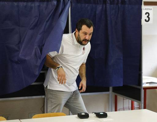 Leader of the Northern League party Matteo Salvini leaves the polling booth after casting his ballot in Milan, Italy, Sunday, Oct.22, 2017. Voters in the wealthy northern Italian regions of Lombardy and Veneto are heading to the polls to decide if they want to seek greater autonomy from Rome, riding a tide of self-determination that is sweeping global politics. (AP Photo/Luca Bruno)