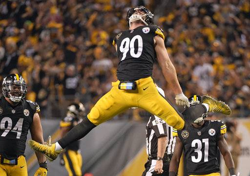 Pittsburgh Steelers outside linebacker T.J. Watt (90) celebrates his sack of Cincinnati Bengals quarterback Andy Dalton during the second half of an NFL football game in Pittsburgh, Sunday, Oct. 22, 2017. (AP Photo/Fred Vuich)