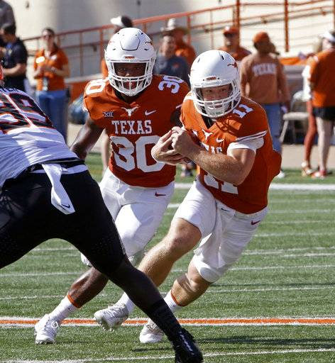 Texas quarterback Sam Ehlinger (11) runs the ball during the first half of an NCAA college football game against Oklahoma State, Saturday, Oct. 21, 2017, in Austin, Texas. (AP Photo/Michael Thomas)