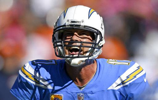 Los Angeles Chargers quarterback Philip Rivers yells to his team during the second half of an NFL football game against the Denver Broncos Sunday, Oct. 22, 2017, in Carson, Calif. (AP Photo/Mark J. Terrill)