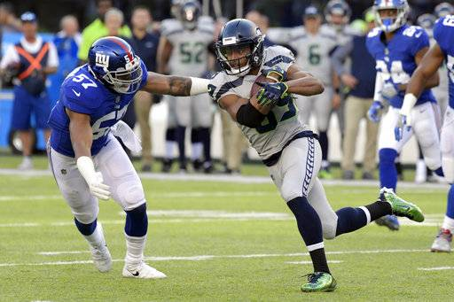 Seattle Seahawks' Doug Baldwin, right, tries to evade New York Giants' Keenan Robinson during the first half of an NFL football game, Sunday, Oct. 22, 2017, in East Rutherford, N.J. (AP Photo/Bill Kostroun)