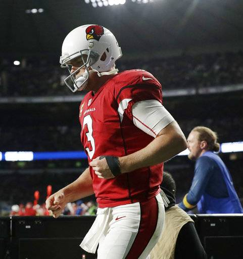 Arizona Cardinals quarterback Carson Palmer (3) leaves the field injured during the first half of an NFL football game against Los Angeles Rams at Twickenham Stadium in London, Sunday Oct. 22, 2017. (AP Photo/Matt Dunham)