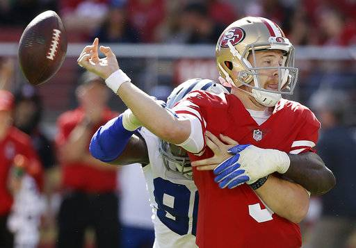 San Francisco 49ers quarterback C.J. Beathard (3) fumbles as he is hit by Dallas Cowboys defensive end Demarcus Lawrence during the first half of an NFL football game in Santa Clara, Calif., Sunday, Oct. 22, 2017. The Cowboys recovered the ball. (AP Photo/Eric Risberg)