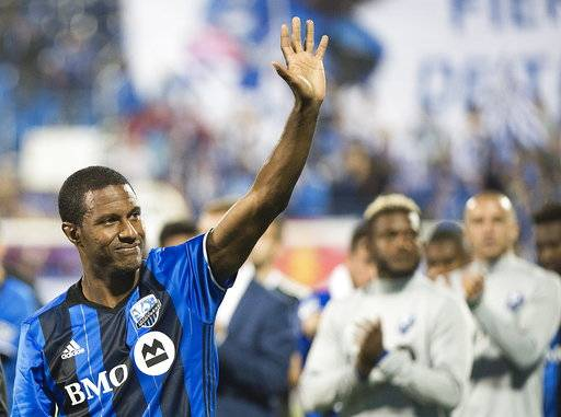 Montreal Impact's Patrice Bernier waves to fans following his final MLS soccer game, against the New England Revolution in Montreal, Sunday, Oct. 22, 2017. (Graham Hughes/The Canadian Press via AP)