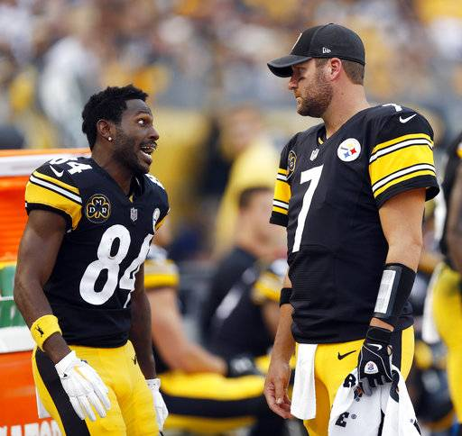 Pittsburgh Steelers wide receiver Antonio Brown (84) talks with quarterback Ben Roethlisberger on the sideline during the first half of an NFL football game against the Cincinnati Bengals in Pittsburgh, Sunday, Oct. 22, 2017. (AP Photo/Keith Srakocic)
