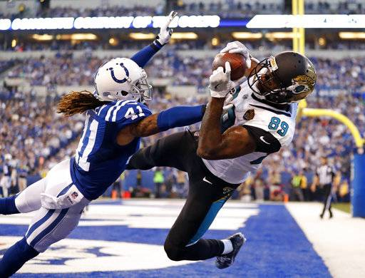 Jacksonville Jaguars tight end Marcedes Lewis (89) makes a catch for a touchdown over Indianapolis Colts strong safety Matthias Farley (41) during the first half of an NFL football game in Indianapolis, Sunday, Oct. 22, 2017.