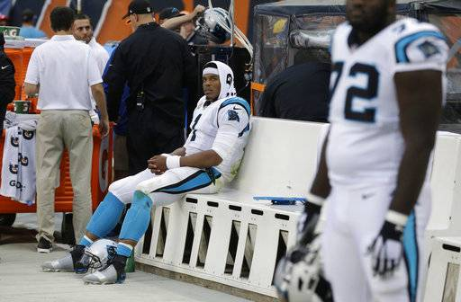 Carolina Panthers quarterback Cam Newton, left, sits on the bench during the closing minutes of the second half of an NFL football game against the Chicago Bears, Sunday, Oct. 22, 2017, in Chicago. Chicago won 17-3. (AP Photo/Charles Rex Arbogast)