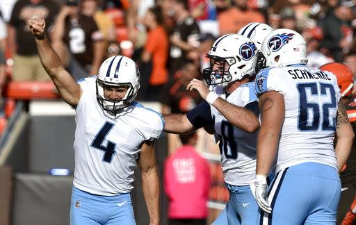 Tennessee Titans kicker Ryan Succop (4) celebrates after making a winning 47-yard field goal in overtime in an NFL football game against the Cleveland Browns, Sunday, Oct. 22, 2017, in Cleveland. (AP Photo/David Richard)