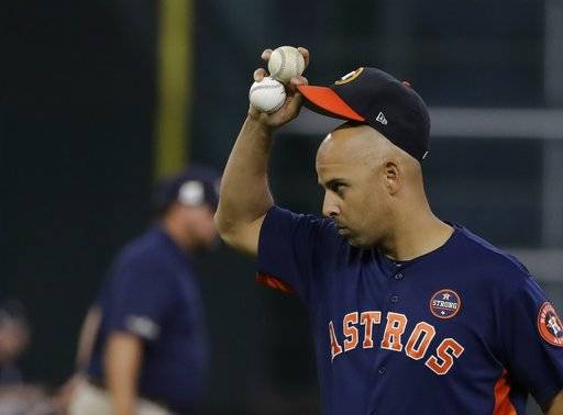 Houston Astros bench coach Alex Cora tips his hat during batting practice before Game 6 of the American League Championship Series baseball game against the New York Yankees Friday, Oct. 20, 2017, in Houston. (AP Photo/David J. Phillip)