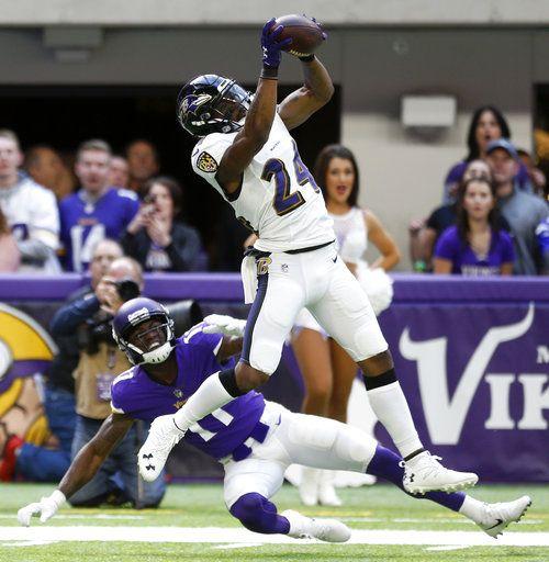 16ec3f3983b Baltimore Ravens cornerback Brandon Carr (24) intercepts a pass intended  for Minnesota Vikings wide