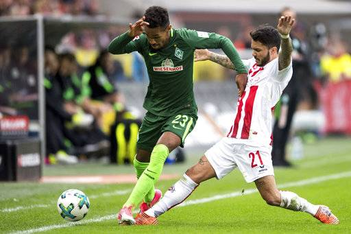 Cologne's Leonardo Bittencourt, right, and Bremen's Theodor Gebre Selassie challenge for the ball during a German Bundesliga soccer match between 1. FC Cologne and SV Werder Bremen, in Cologne, Germany, Sunday, Oct. 22, 2017. (Marius Becker/dpa via AP)