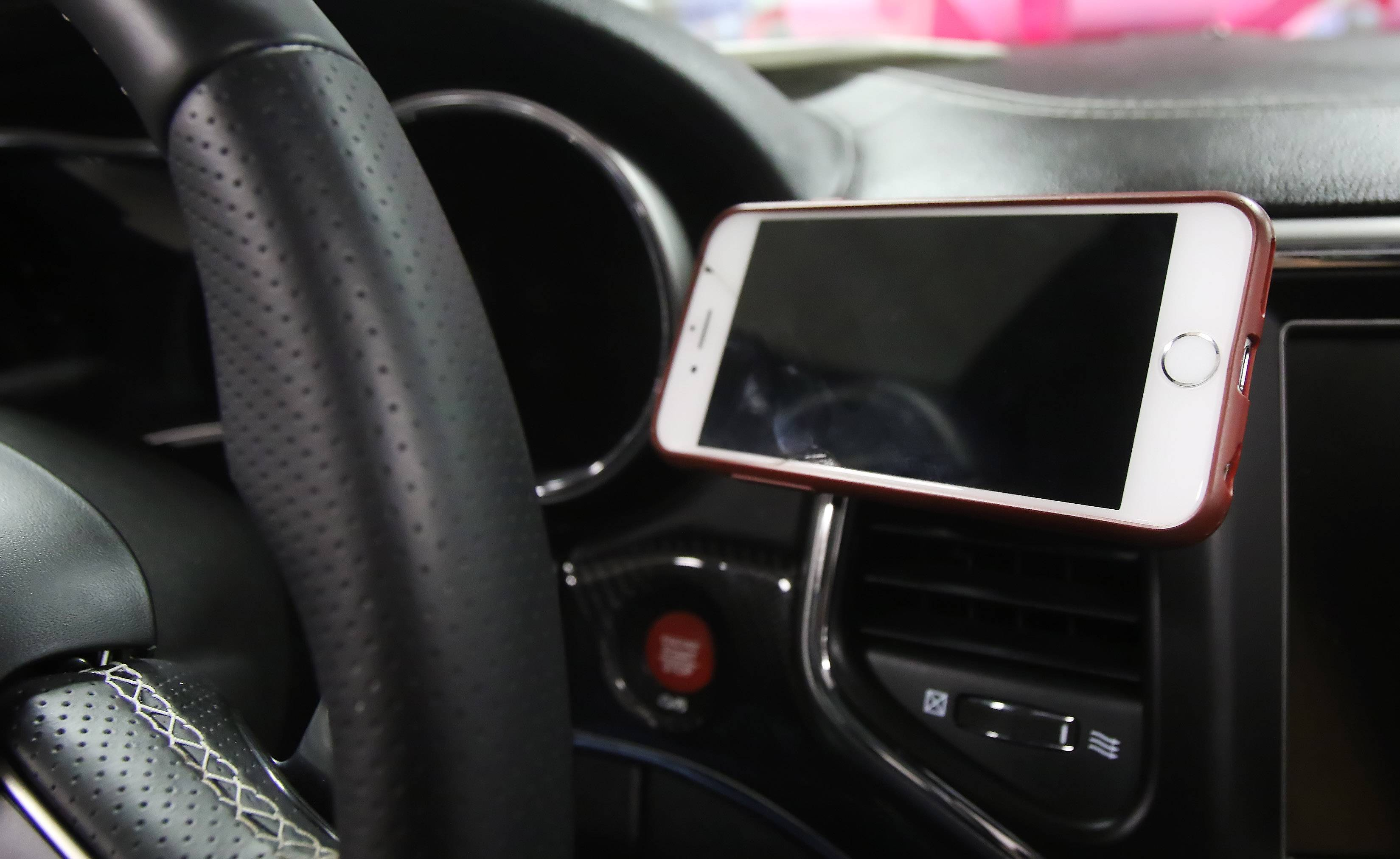 Text and drive? Where you could get a phone cradle instead of a ticket