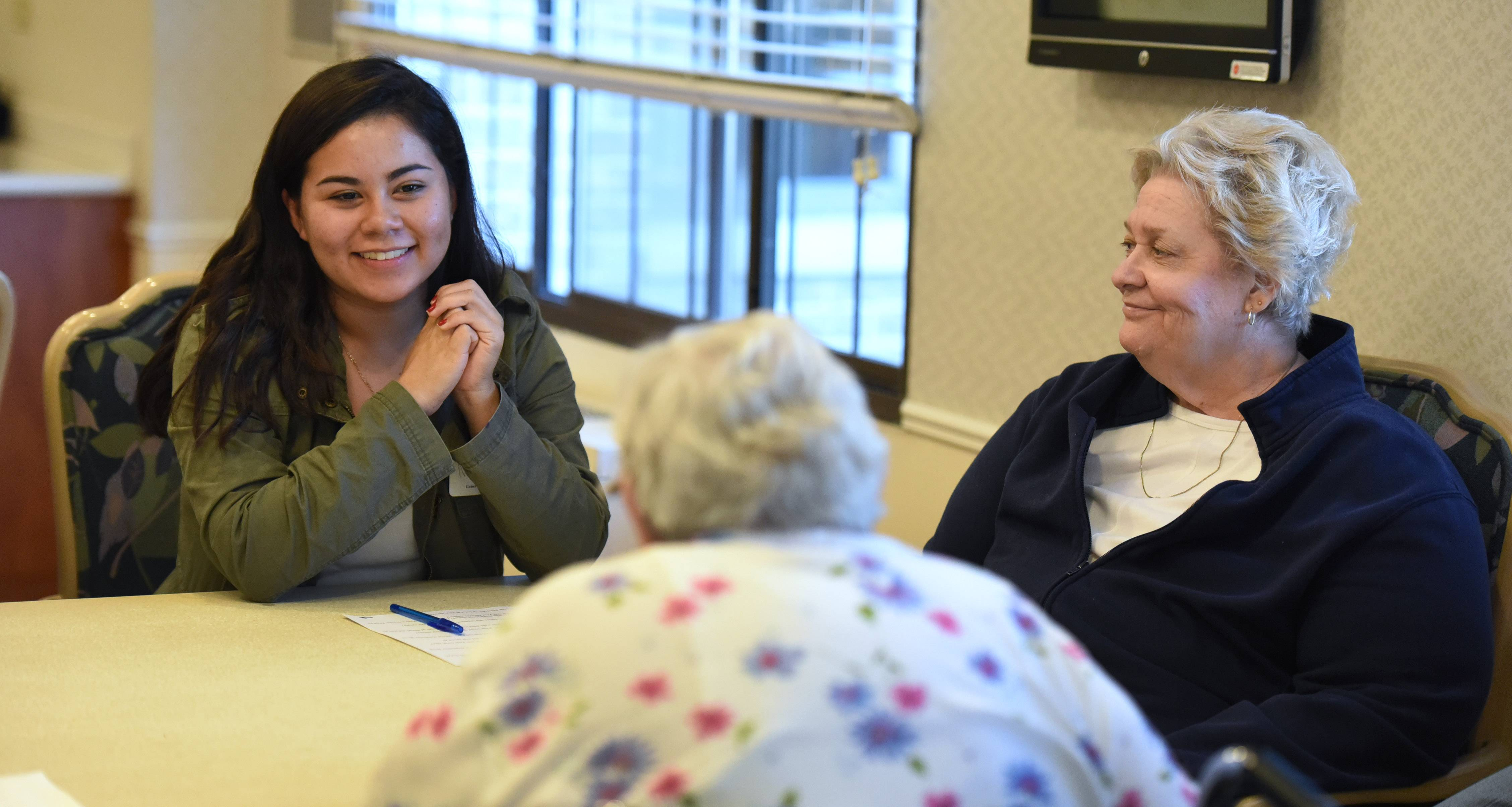 Wheeling High School student Ivette Lopez, left, talks with Lexington Health Care Center residents including Christine Streff, right, during a Generation to Generation program sponsored by Wheeling Township.