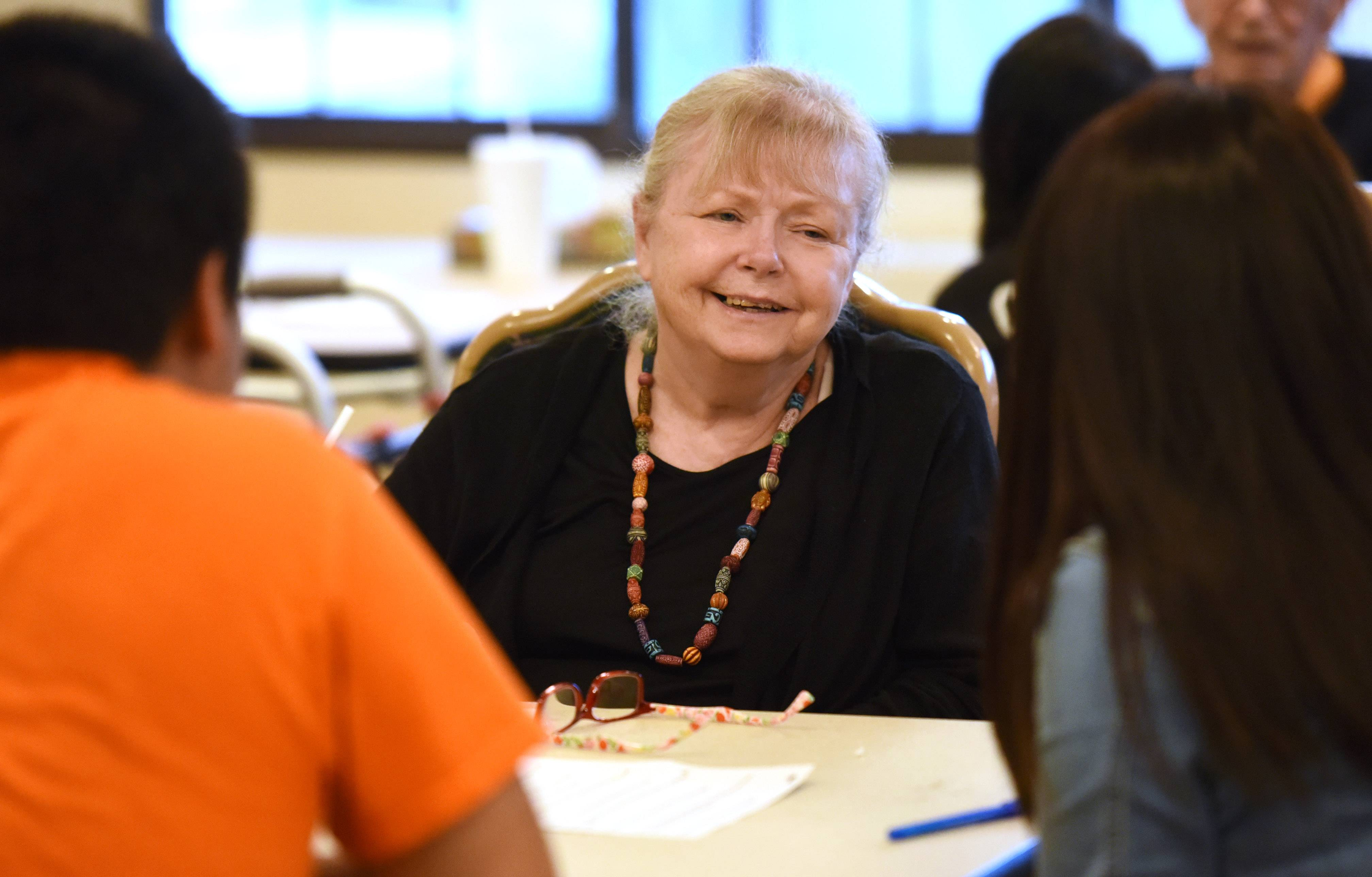 Lexington Health Care Center resident Kathy Morris chats with Wheeling High School students during a visit to the Wheeling center.